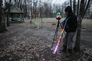 This behind the scenes image shows Greg McNevin testing lightpainting equipment to be used to highlight contamination in the town of Zlynka, Russia. Greenpeace/Evgeny Usov