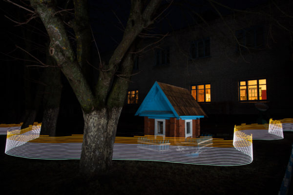 A special light painting tool displays radiation levels in real-time at a school in Starye Bobovichi (Старые Бобовичи). Here white light shows contamination levels up to 0.23uSv/h (Japan's guide for decontamination), while orange highlights elevated levels – from 0.30uSv/h to 0.65uSv/h around these trees and children's play house. 30 years after the 1986 Chernobyl nuclear disaster, the schoolyard still contains areas of elevated radiation levels. This image has not been digitally manipulated outside of minor contrast and exposure adjustments. Greenpeace/Greg McNevin