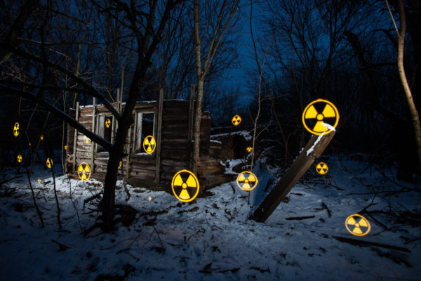 A Pixel Stick is used to paint nuclear symbols and messages in front of a decaying house in the village of Svyatsk (Святск), Russia. Like the rest of the village, the contaminated house was abandoned in the wake of the 1986 Chernobyl nuclear disaster areas. Greenpeace/Greg McNevin