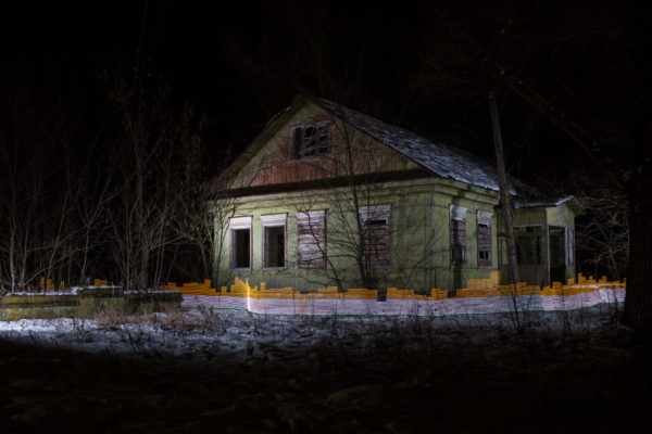 A special light painting tool displays radiation levels in real-time at an abandoned home in the centre of Starye Bobovichi (Старые Бобовичи), Russia. Here white light shows contamination levels up to 0.23uSv/h, while orange highlights elevated levels – from 0.50uSv/h to 0.85uSv/h and higher. 30 years after the 1986 Chernobyl nuclear disaster, the schoolyard still contains areas of elevated radiation levels. No digital manipulation is involved in the image. Greenpeace/Greg McNevin
