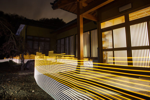 A special light painting technique reveals radioactive contamination surrounding the Sato family house in Iitate. The property has been decontaminated, but contamination from the surrounding forests continually re-contaminates the house. Here we see radiation levels between 0.2uSv/h and 0.5uSv/h, with yellow showing spots elevated above the government decontamination target of 0.23 uSv/h. Greenpeace/Greg McNevin